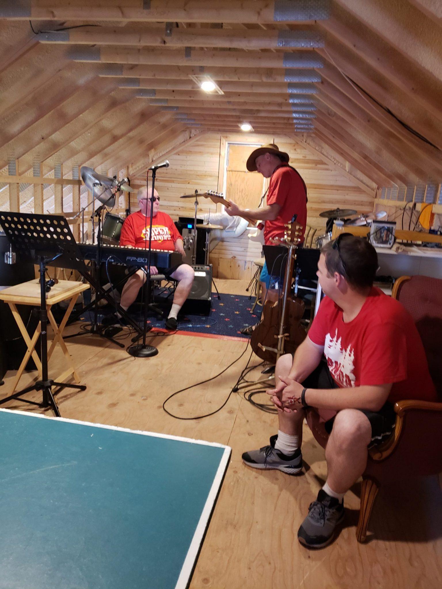 Guitar player, Dave Curran tunes up.